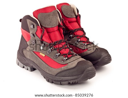 New trekking boots on white background