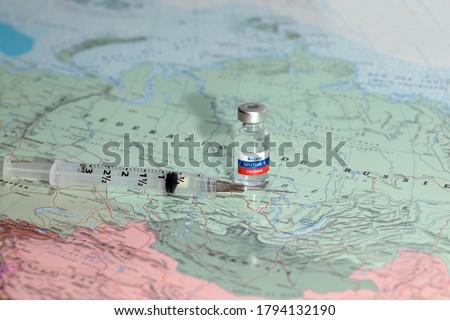 New vaccine sputnik-v on map russia background. Coronavirus vaccine. Covid-19, 2019-nCov pandemic.