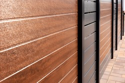 New varicoloured and stylish high plastic fence. Vinyl products. Protection of the house
