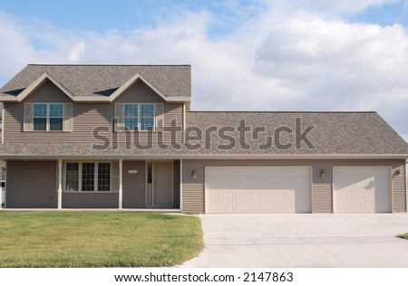 New vinyl sided home with large porch and 3 stall garage