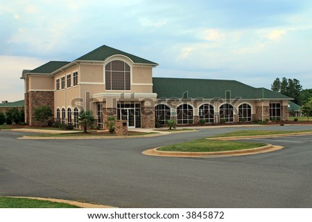 New, well maintained office building, front view.