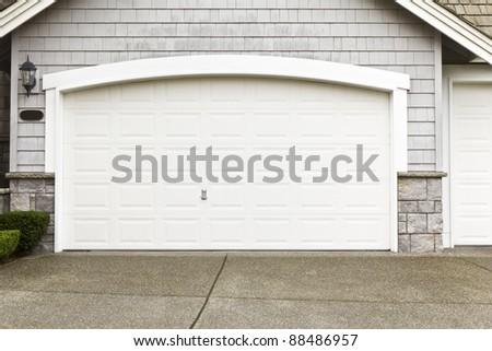 New white paint job on garage frame door- enamel
