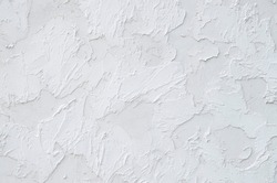 New white painted plaster om wall closeup