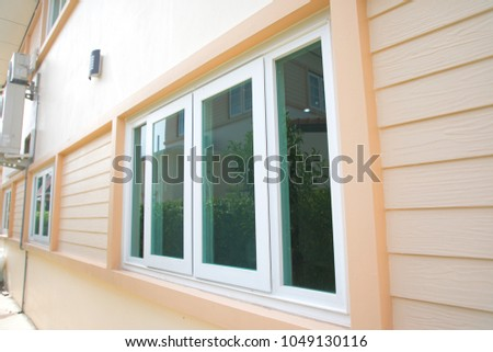 new window with window blinds on wood walls. #1049130116