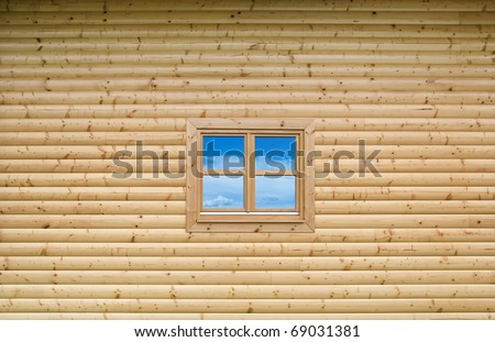 New Wooden cottage exterior facade wall with closed window