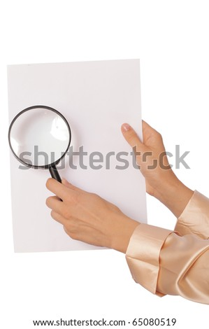 New worker looking at the white blank paper with a magnifier
