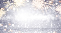 New Year Abstract background holiday, Gold and silver Fireworks and bokeh, copy space.