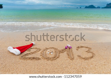 New year 2013 and Christmas beach vacation and holiday concept. 2013 written on tropical beach sand