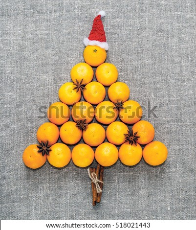 New year and Christmas card. Holiday and celebration concept. Christmas  spices in a boat on mandarins.