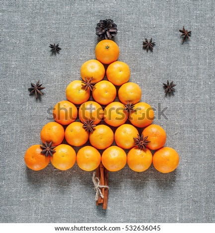 New year and Christmas card. Holiday and celebration concept. Christmas tree of tangerines with star anise. Christmas and New Year\'s background.