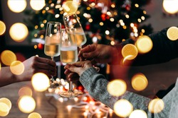 New year and Christmas celebration with champagne in front the Christmas tree.
