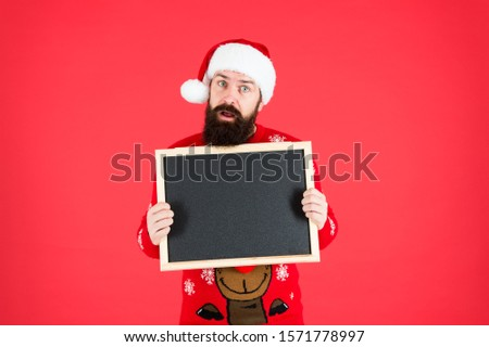 New year and Christmas publicity. Bearded man hold blank publicity board. Santa Claus display school publicity. Publicity and education, copy space.