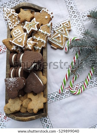 New Year and Christmas theme. Spiced cookies decorated with icing and chocolate with cream filling #529899040