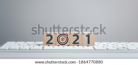 New year 2021 and goal target plan, wood cubes with New year 2021 and goal or target icon. concept of New year Business goals and vision.
