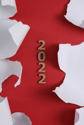 New year 2022 and White Torn paper sheet on red background. Chris
