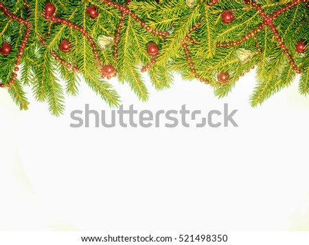 New Year background. Red balls toys and beads on a spruce. Decorated Green Christmas fir tree on white #521498350