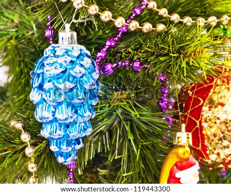 New year background with beautiful blue cone on furtree
