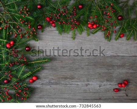 new year background with christmas tree dogrose and red balls on old wooden background