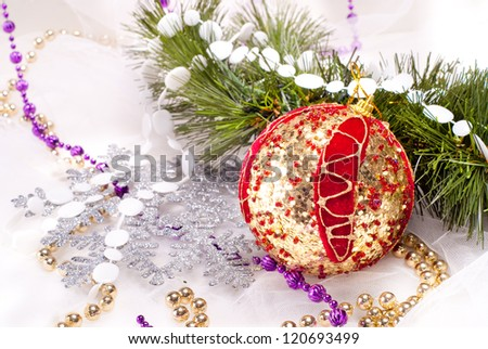 New year background with red decoration ball and fur tree branch