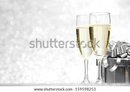 New year card with Champagne and gift on shiny glitter background #159598253