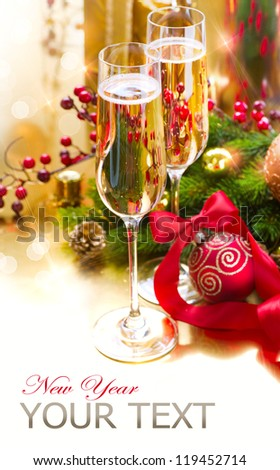 New Year Celebration. Christmas.Two Champagne Glasses on Holiday Setting Table