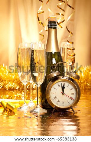 New Year - champagne, decoration and clock face - stock photo