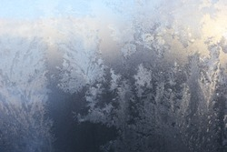 New year Christmas background. Frosty pattern, freeze on the window in winter
