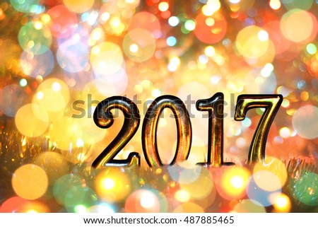 New year, Christmas background of colored holiday lights. Gold numbers 2017.