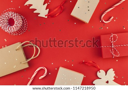 New Year Christmas presents wrapped ribbon flat lay top view Xmas holiday 2019 celebration handmade gift boxes red paper golden sparkles background copyspace. Template mockup greeting card text design #1147218950