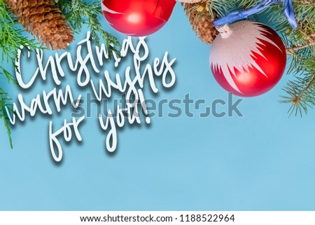 """new year christmas two color flat lay wishlist and wishing text with pine branches and decoration toys concept """"warm wishes for you"""" #1188522964"""