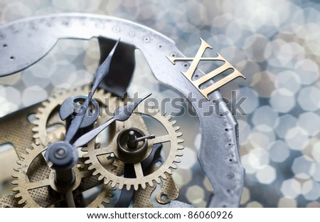 new year clock with glittering holiday lights - stock photo