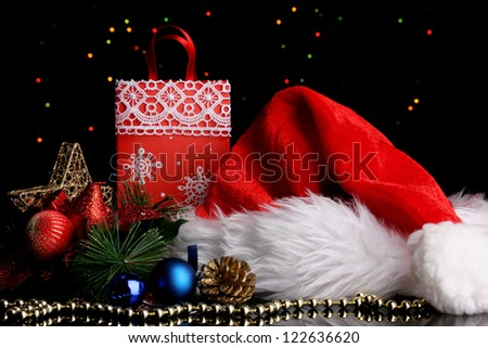 New Year composition of New Year's decor and gifts on Christmas lights background