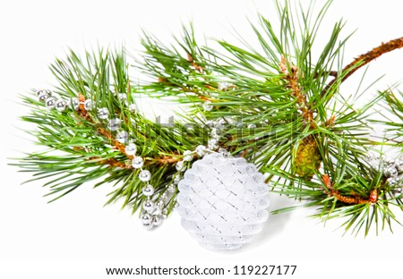 New Year composition with fir tree branch and white ball isolated on white