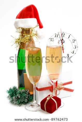 New Year composition with gifts, clock and champagne on white background - stock photo