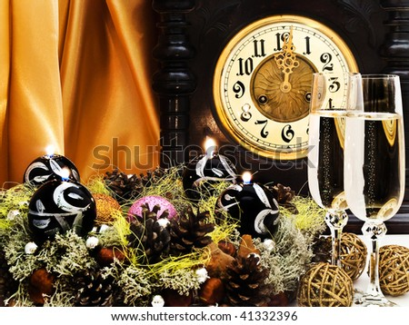 New Year composition with old clock, champagne and garland with candles