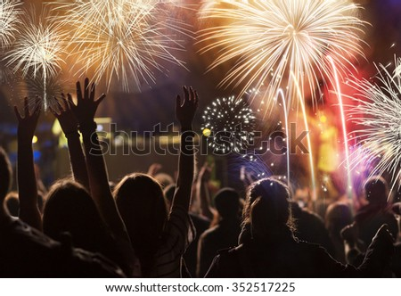 New Year concept - cheering crowd and fireworks #352517225