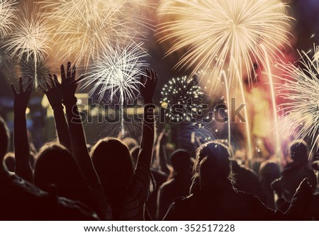 New Year concept - cheering crowd and fireworks #352517228