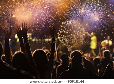New Year concept - cheering crowd and fireworks #490918144