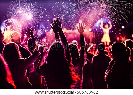New Year concept - cheering crowd and fireworks #506763982