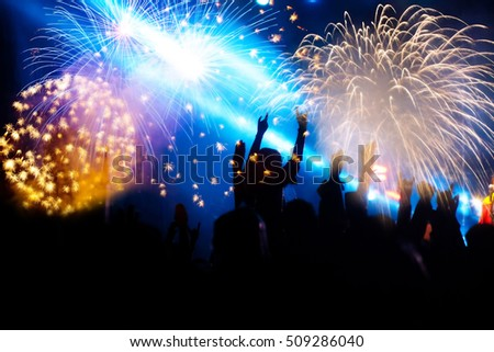 new Year concept - cheering crowd and fireworks #509286040