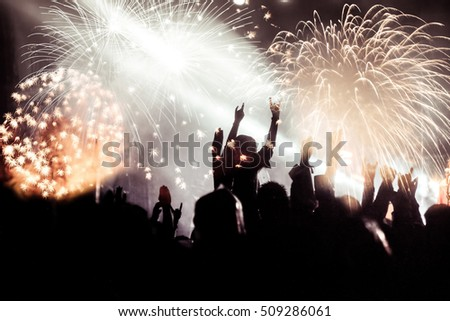 new Year concept - cheering crowd and fireworks #509286061