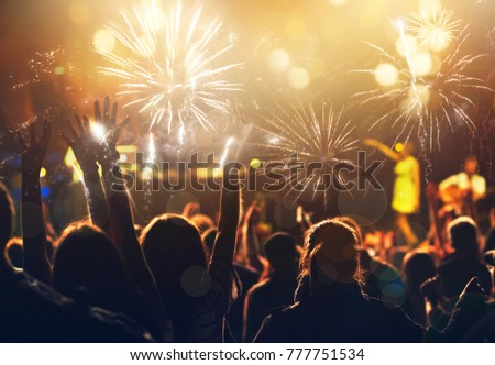 new Year concept - cheering crowd and fireworks #777751534