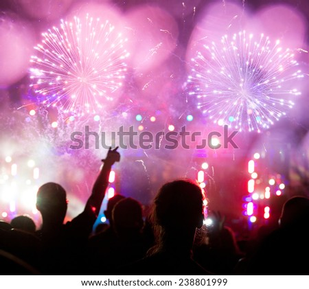 New Year concept -  fireworks and cheering crowd celebrating the New year #238801999