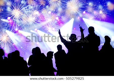 New Year concept with celebrating crowd and fireworks #505279825