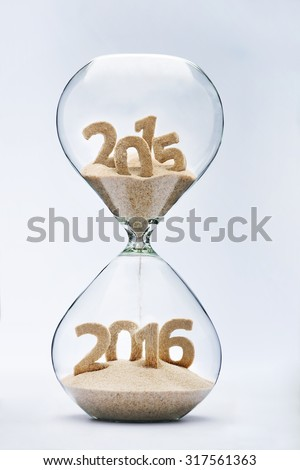 New Year 2016 concept with hourglass falling sand taking the shape of a 2016 #317561363