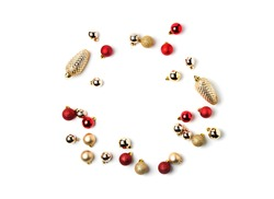 New year creative arrangement frame of bright red and golden balls isolated on white background. Christmas flat lay, top view. Festive frame with copy space for text