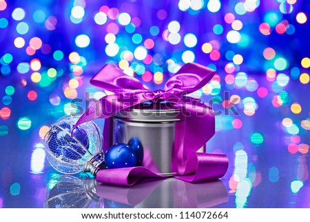 New Year decorations composition with fancy box on bokeh background