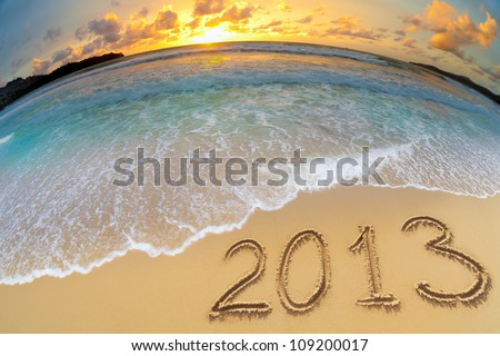 new year 2013 digits on ocean beach sand - stock photo