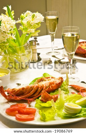 New Year dinner with a cooked lobster plate - stock photo