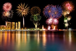 New year firework over lighthouse on the Muelle uno in Malaga city, Spain